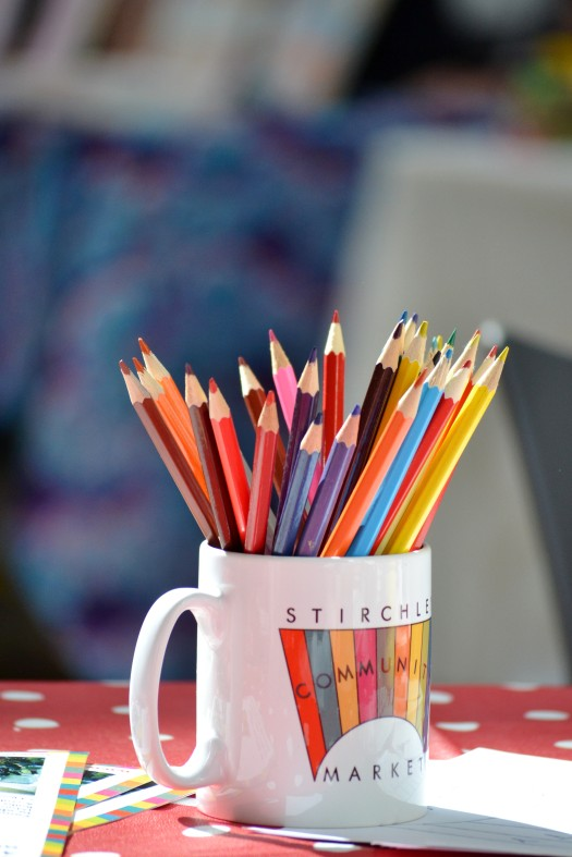 Sunshine on a Market mug full of coloured pencils