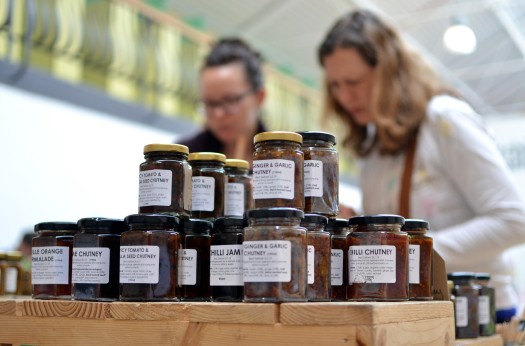 Customers taking a close look at jars from Cuffufle Preserves