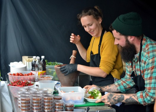Preparing food on the Thai pop-up stall run by Loaf Community Bakery
