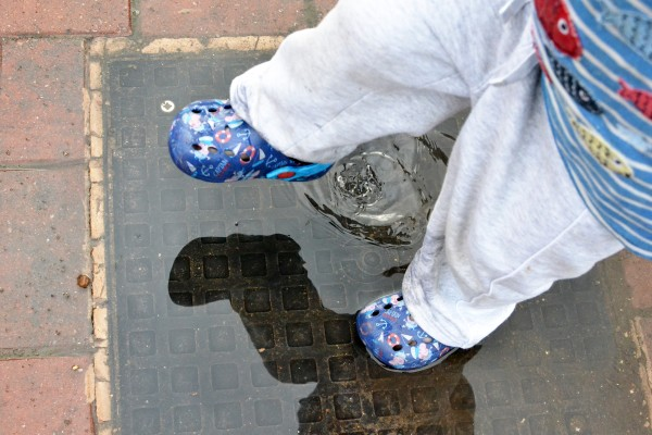 Small feet stamping in a puddle