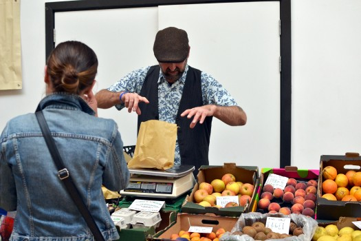 Tom of Vegetropolis weighing out produce