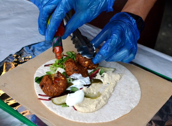 Making a falafel wrap at the Just Falafs stall