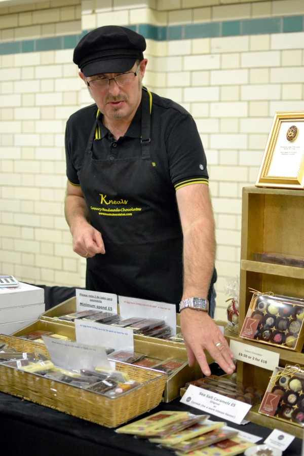 Neil with a wide range of chocolate bars and other products