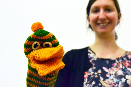 A knitted hand puppet