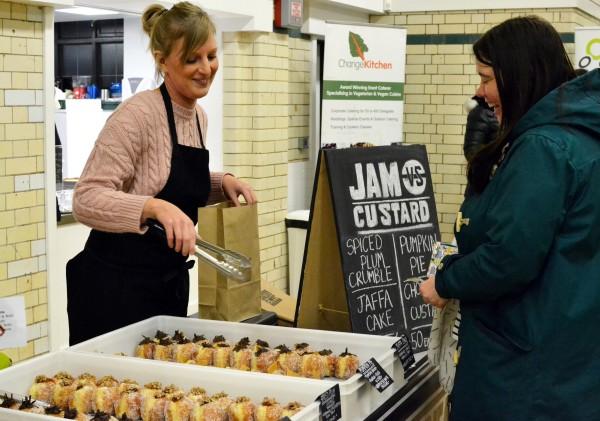 A customer at the Jam vs Custard stall