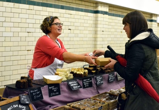 A customer buying from Mrs Mills Makes Cakes