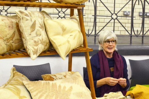Lucy with a range of fabric-covered cushions