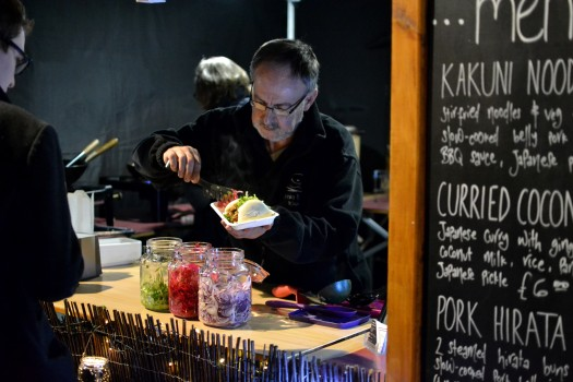 Serving Japanese street food on the Gresko Bodhi stall