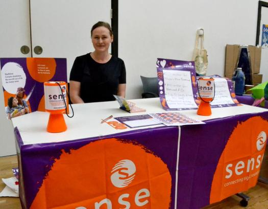 Raffle stall raising funds for Sense charity
